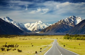 Visit-New-Zealand-Landscape-With-Road-and-Snowy-Mountains-Southern-Alps-New-Zealand-1600x1047